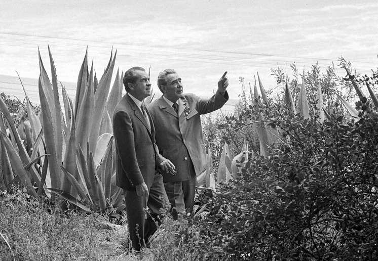 In this June 23, 1973 file photo, with the Pacific Ocean in the background, President Richard Nixon, left, and Soviet Communist Party leader Leonid I. Brezhnev take a stroll on the grounds during a break in their talks at Nixon's home in San Clemente, Calif.