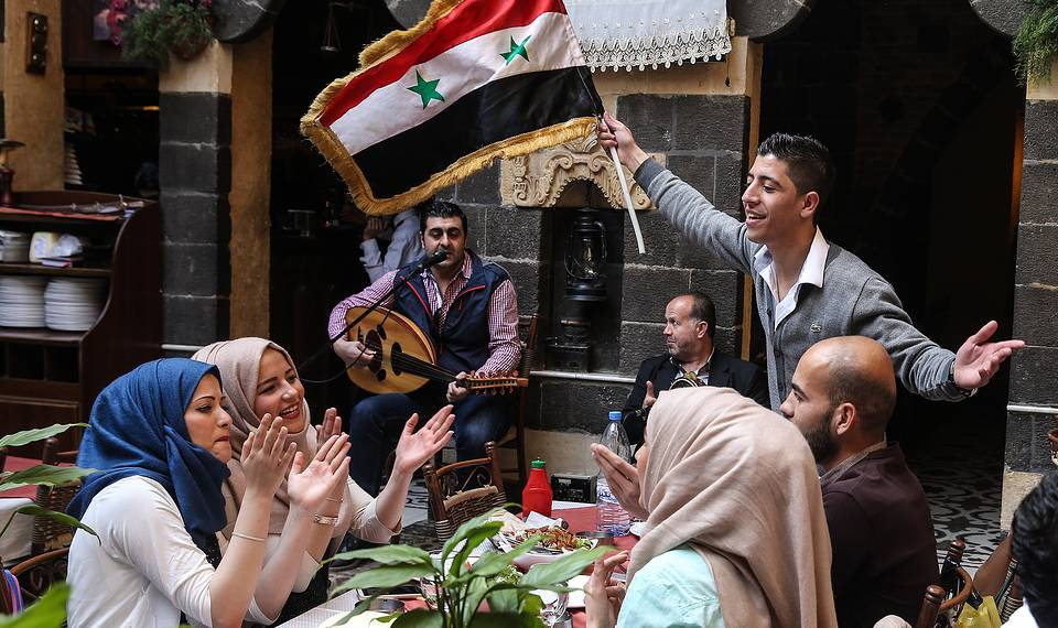 People in a restaurant in Damascus, April 2, 2016 Valery Sharifulin/TASS